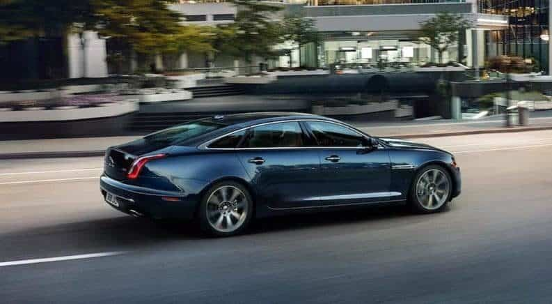 Black 2018 Jaguar XJ Driving on Street