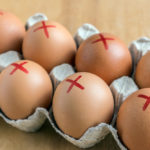Eggs marked with a red ex to represent recall.