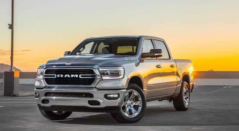Silver 2019 Ram 1500 in parking lot at sunset