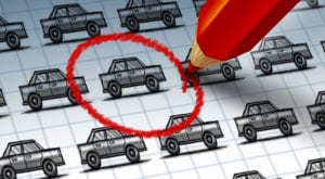 Car shopping concept with a red pencil circling a drawing from a group of cars