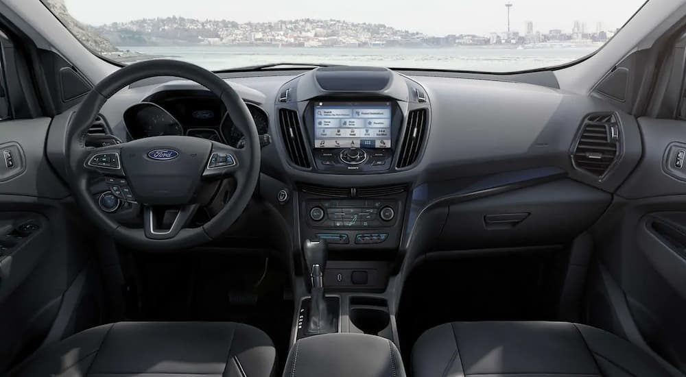 The black interior of a 2019 Ford Escape is shown. Check out interior features when comparing the 2019 Ford Escape vs 2019 Honda CR-V.
