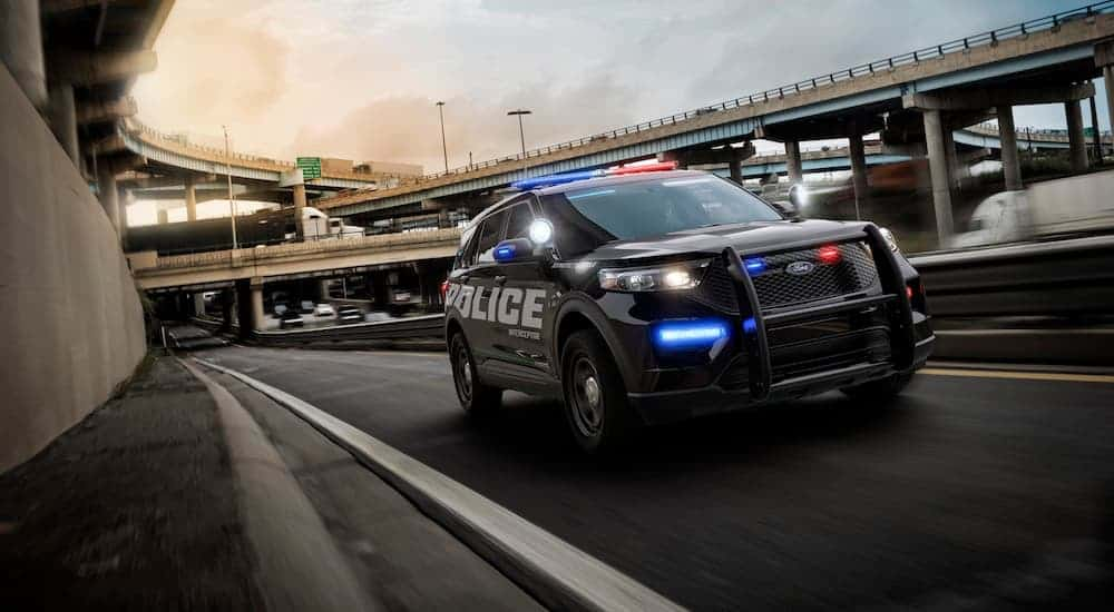 A 2020 Ford Explorer Interceptor is driving on a highway.