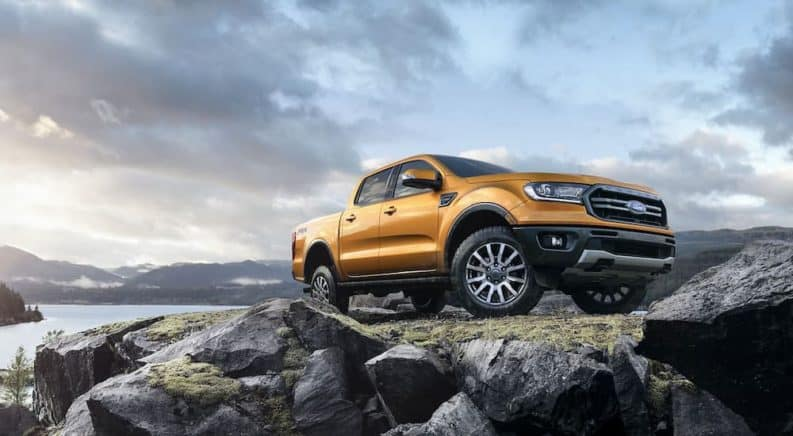 A gold 2019 Ford Ranger is shown on a rocky area from a low angle.