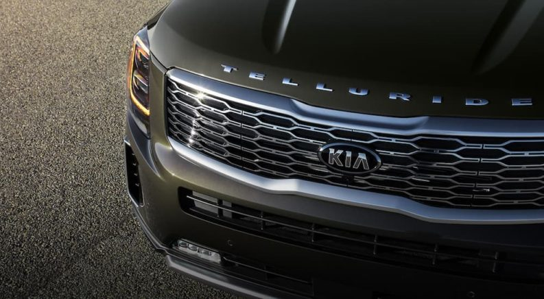 The front end of a green 2020 Kia Telluride is shown in a closeup.