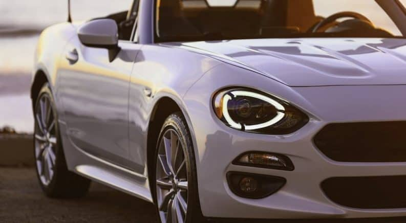 A close up of a white 2019 Fiat 124 Spider.
