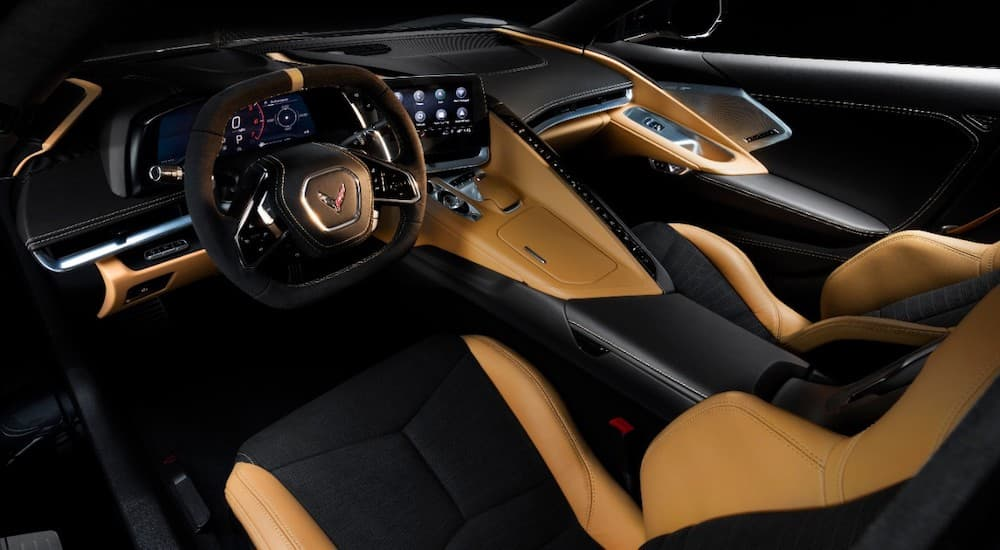 The black and tan interior of the 2020 Chevy Corvette is shown.