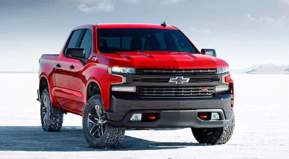 A red 2020 Chevy Silverado LT Trail Boss is parked on a flat salt land.