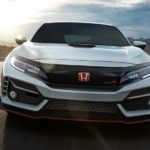 A white 2020 Honda Civic Type R is shown from the front on a race track.