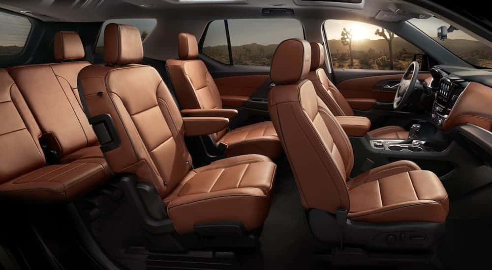 The brown interior of a 2020 Chevy Traverse is shown from the side.