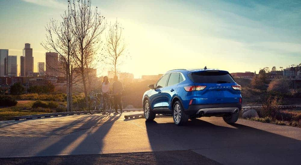 Is this the best SUV? A blue 2020 Ford Escape is overlooking a city at sunset.