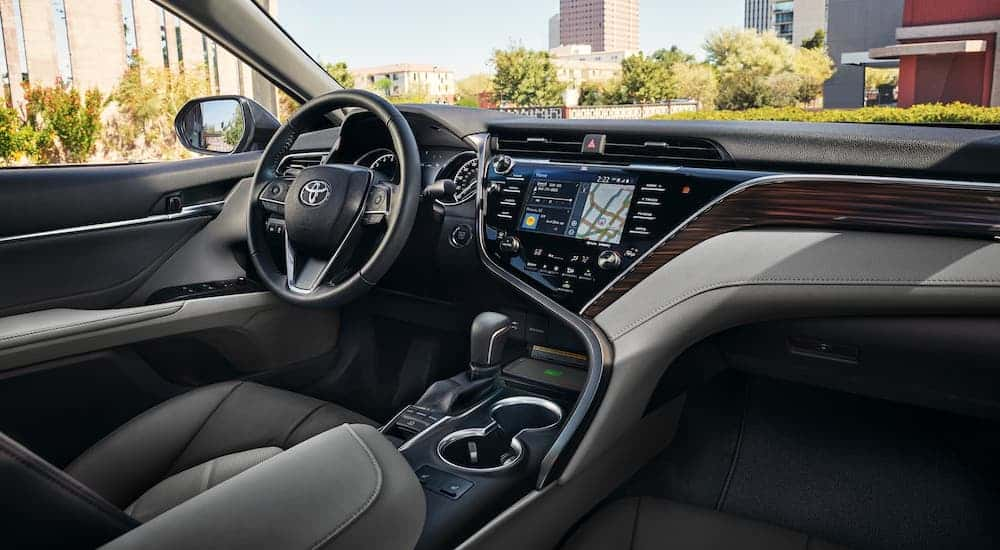 The luxurious and high tech interior of a 2020 Toyota Camry is shown.