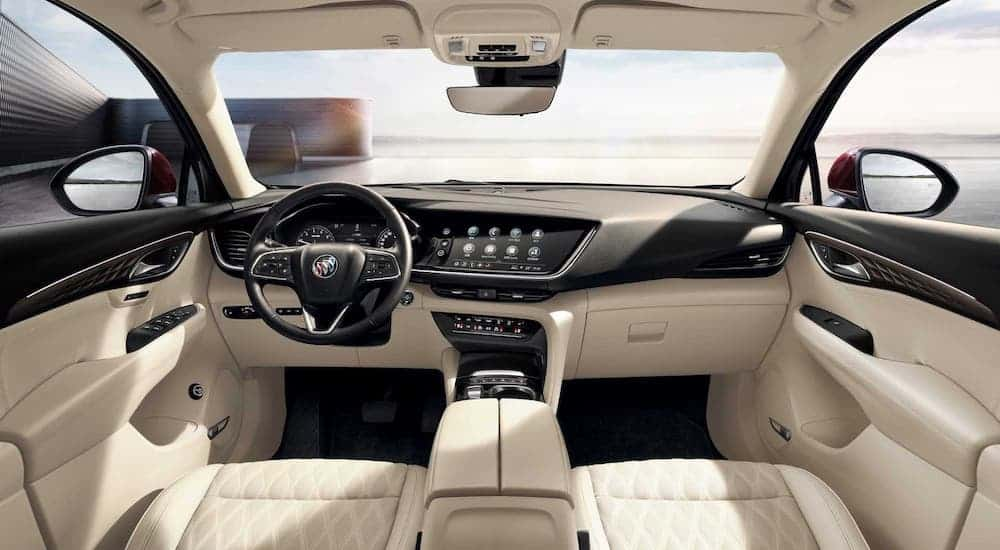 The white and black interior if a 2021 Buick Envision is shown.