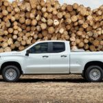 A white 2021 Chevy Silverado 1500 WT is parked in a lumber yard after winning the 2021 Chevy Silverado 1500 vs 2021 Ford F-150 showdown.