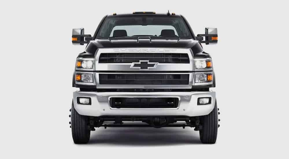 A black 2021 Chevy Silverado 4500 is shown from the front against a gray background.