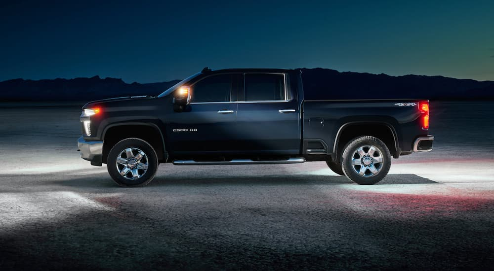 A black 2021 Chevy Silverado HD is shown from the side in the desert.