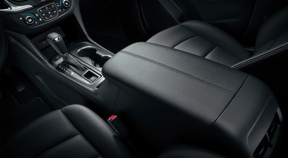 The black center console is shown from a high angle on a 2021 Chevy Equinox.