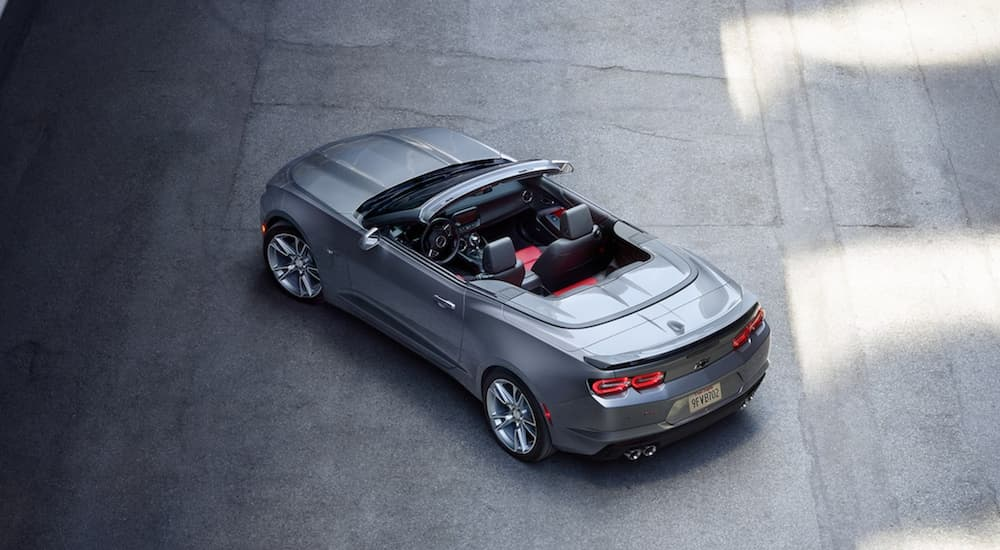 A grey 2021 Chevy Camaro 3LT convertible is shown from a high angle parked on concrete.
