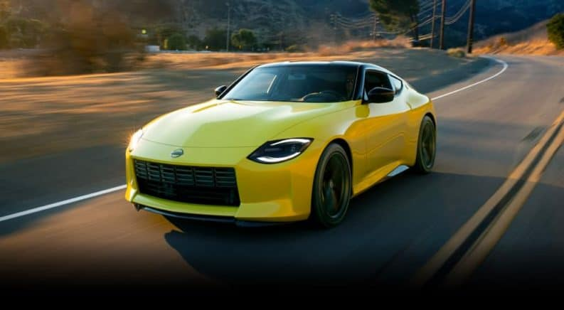 A yellow 2021 Nissan Proto Z is shown driving down the highway after leaving a Nissan dealership.