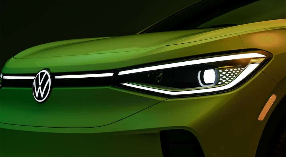A close up shows the headlight and grill on a green 2021 Volkswagen ID.4.