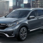 A 2021 Honda CR-V is parked on a roof in the city after winning a 2021 Honda CR-V vs 2021 Toyota RAV4 comparison.