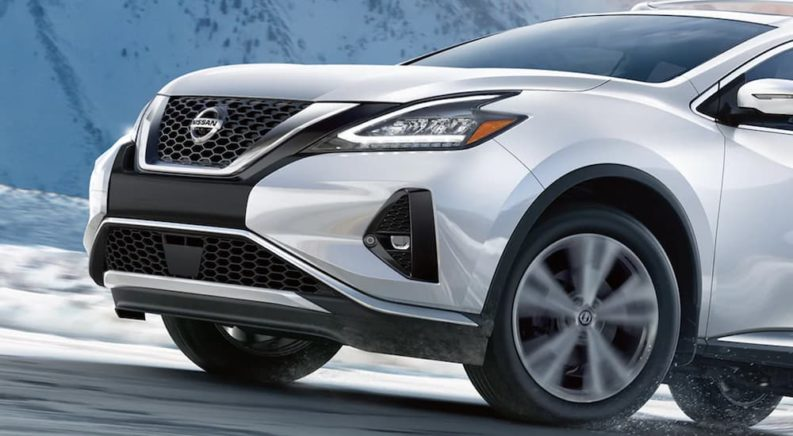 A white 2021 Nissan Murano is shown from the side driving on an open road after winning a 2021 Nissan Murano vs 2021 Chevy Blazer comparison.